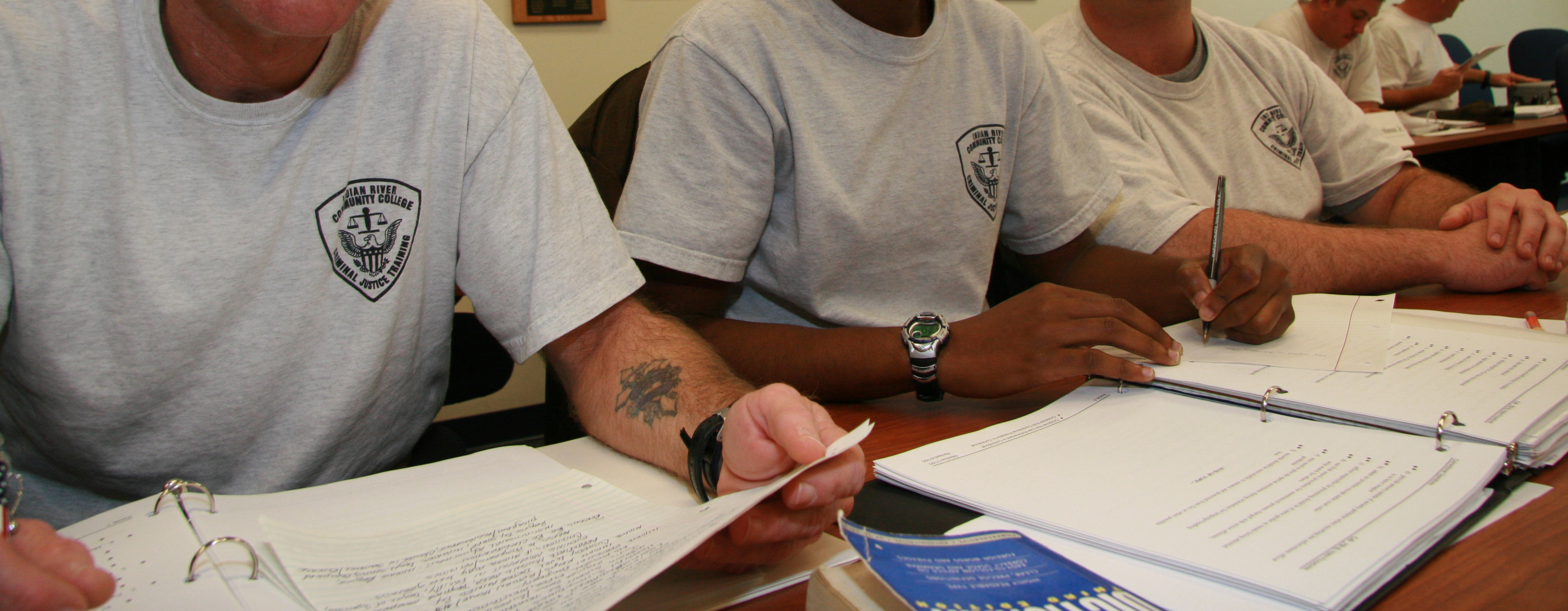 Law Enforcement students taking notes in class